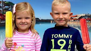 Children buy ice cream on the beach Martin and Monica