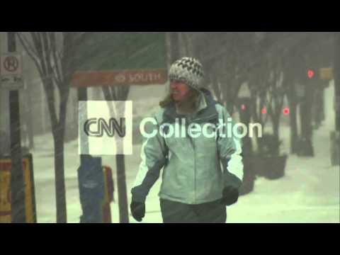 NC: PEOPLE WALKING IN SIDEWAYS SNOW IN CHARLOTTE