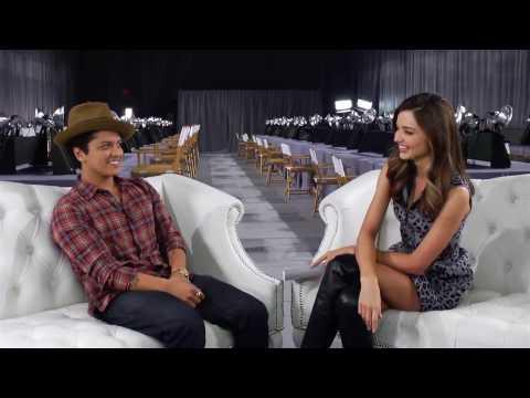Miranda Kerr and Bruno Mars Backstage at...