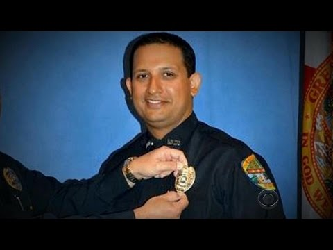 Cop arrested for killing Florida man waiting for tow truck