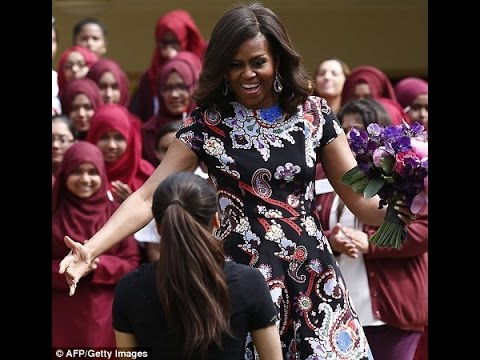 Michelle Obama delights pupils at east London girls' school - after having tea with Prince Harry
