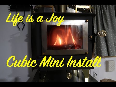 bus-conversion-to-motor-home-#171-wood-stove-installation,-cubic-mini-(grizzly)