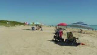 Some Florida beaches reopen amid virus outbreak