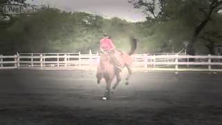 Woman Takes On Bucking Horse Like A Champ
