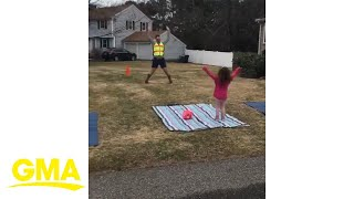 #GirlDad gets his daughters to do home PE 'crossing guard' style