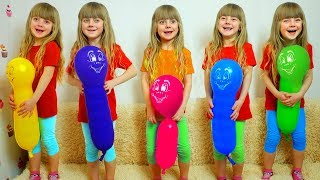 Five little Girls Jumping on the bed with  colored Balloons