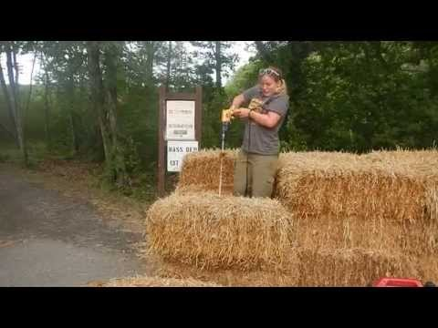 Drilling holes in strawbales