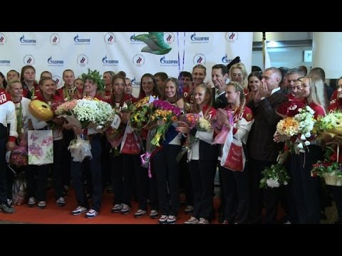 Russian athletes welcomed home in Moscow