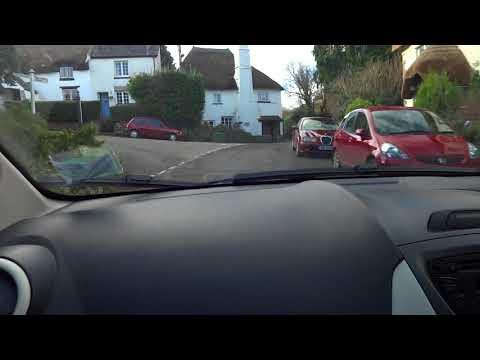 Driving through Ogwell village in Devon, South West England