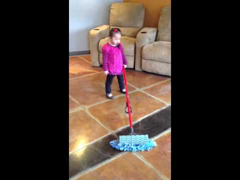 Down syndrome girl learning clean