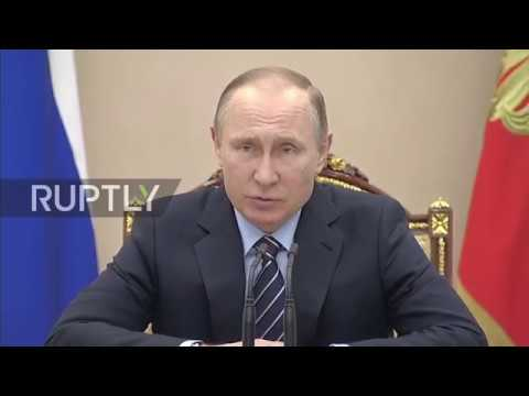 Russia: Putin jokes they 'failed to protect' Medvedev from the flu
