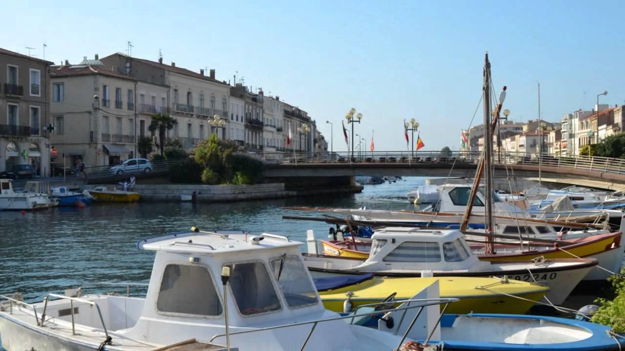 Le centre ville et les canaux de la ville de s te youtube for Piscine fonquerne sete