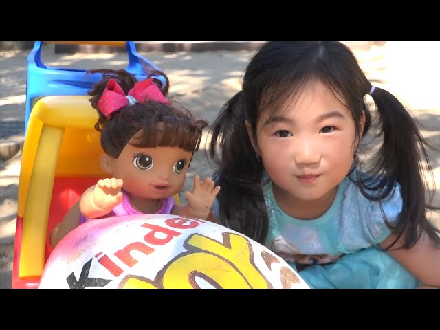 Boram and Baby doll play outdoor playground with kinder joy surprise eggs