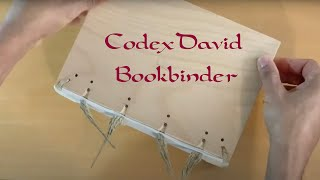 CodexDavid - Attaching the wooden covers of a book to the book block