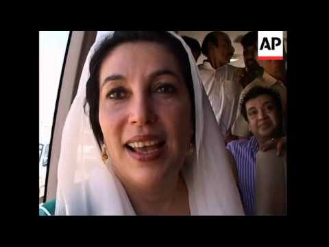 AP pix of Benazir Bhutto on plane from Dubai, arrival, her speaking