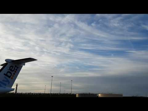 RAF Typhoon and RAF Voyager flying over Birmingham Airport after escorting Cargo Aircraft
