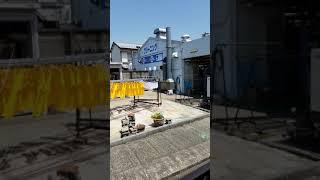 クリーニング店の津島.