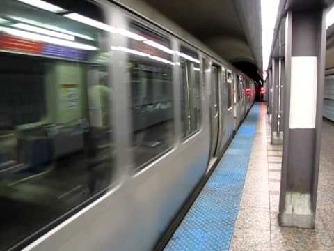 CTA Red Line train departs Grand station