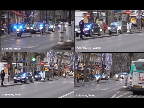 Police motorcycle escort the French prime minister in Paris.