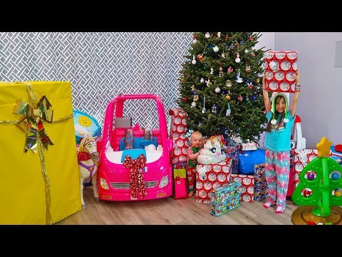 Christmas Morning Opening Presents And Kids Show Favorite New Toys