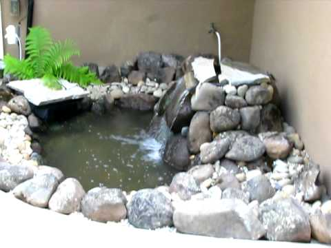Pond waterfall aquascape micropond kit youtube for Garden pond kit