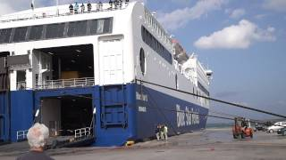 BlueStar Ferry docking in Port Rhodos in stormy weather with rope demolition
