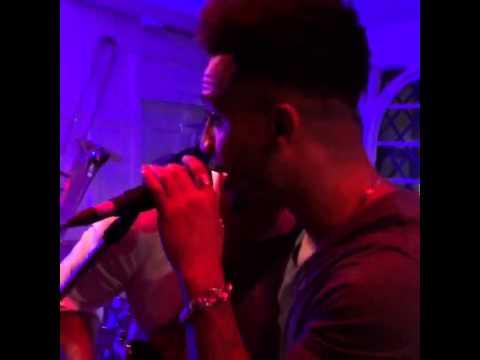 Aston singing karaoke at a club.