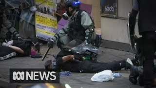 Hong Kong chaos: Police make first widespread arrests during protests | ABC News
