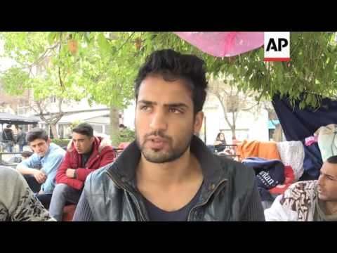 Migrants take shelter in central Athens square