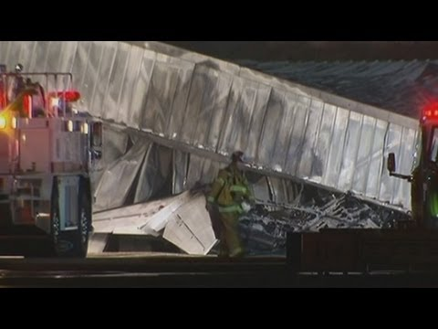 Plane crashes into hangar at Santa Monica Airport in California