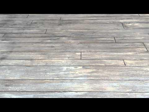 Concrete patio with wood look and nice fleurdilis