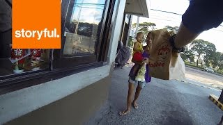 Filipino Biker Gives Out Food to Passing Strangers (Storyful, Inspiring)