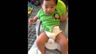 4 months Baby toilet train on Fisher Price Custom Comfort Potty