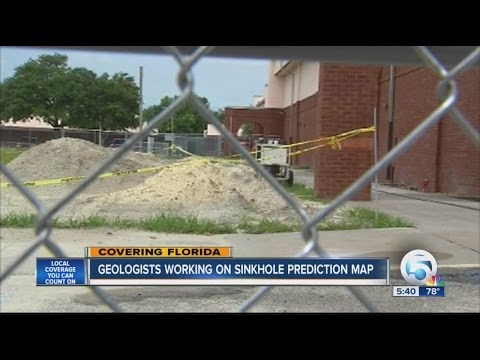 Geologists working on sinkhole prediction map