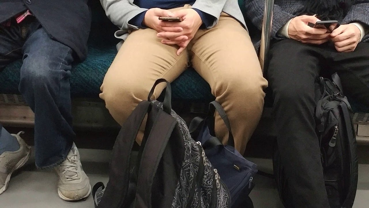 Tokyo subway very tired sleepy man with head movement like Floyd Mayweather Jr