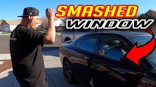 SMASHING A CAR WINDOW