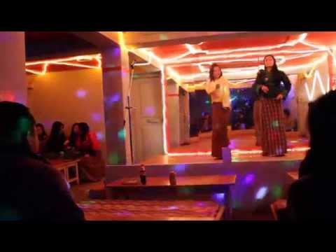 Bhutanese girls dancing to Bollywood songs in a drayang (Bhutan