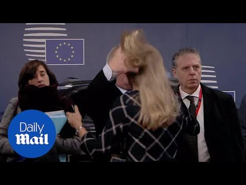 Bizarre moment Jean-Claude Juncker RUFFLES WOMAN'S HAIR?!