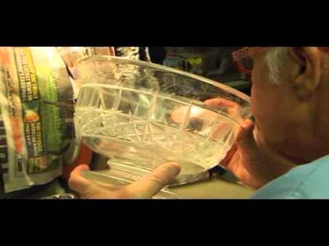 hand cutting a crystal bowl in cobweb