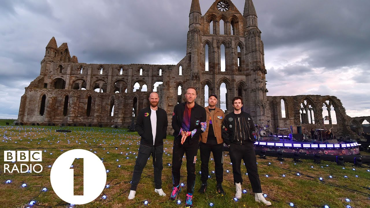 """""""I thought this was a secret!""""  Greg James talks to Coldplay at Whitby Abbey"""