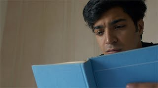 Smart teenager with weak eye-sight trying to read book with concentration