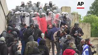 Greek protesters clash with police over name deal