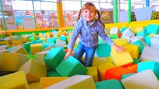 Indoor Playground. Funny baby on play area with song Johny Johny yes papa. Nursery rhymes for kids