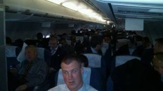 New York Giants on plane celebrating