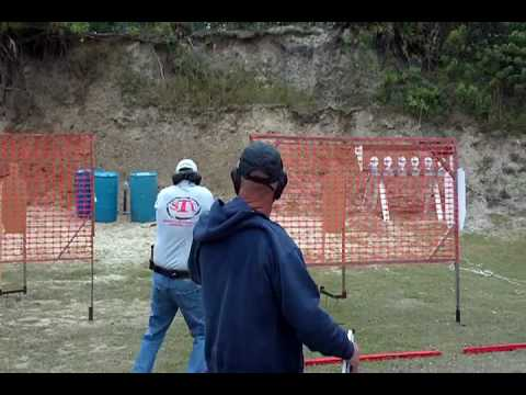 USPSA field course with plate tree and plate rack