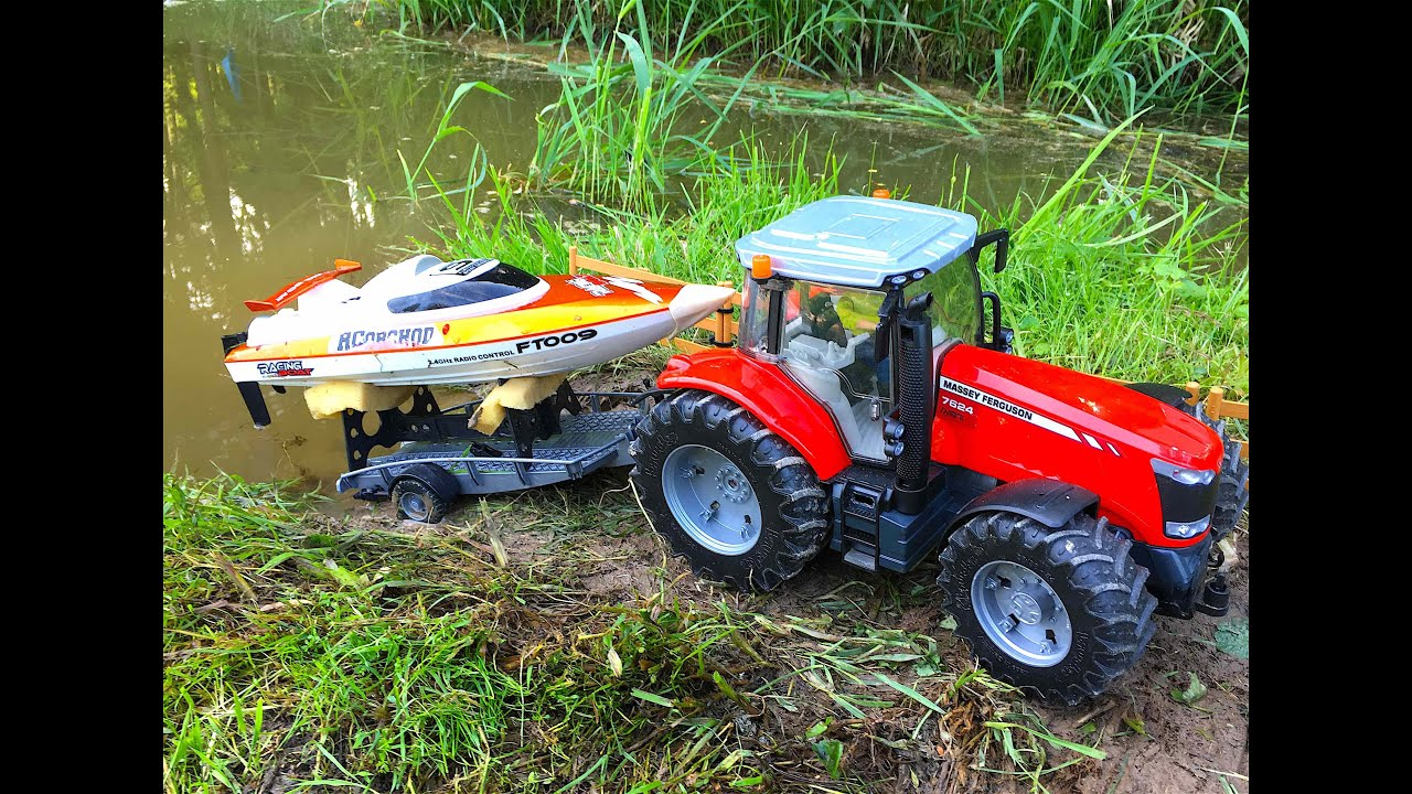 Tractor Pull Boats : Bruder toys rc tractor massey ferguson pulling a boat on
