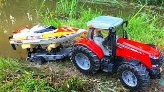 BRUDER TOYS RC Tractor Massey Ferguson pulling a boat on a trailer