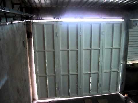 Puerta lateral corrediza seccionada lezca youtube - Puerta de garage ...