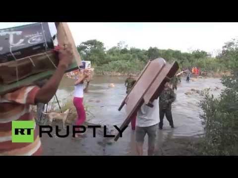 Colombia: Migrants cross Venezuelan border back to homeland