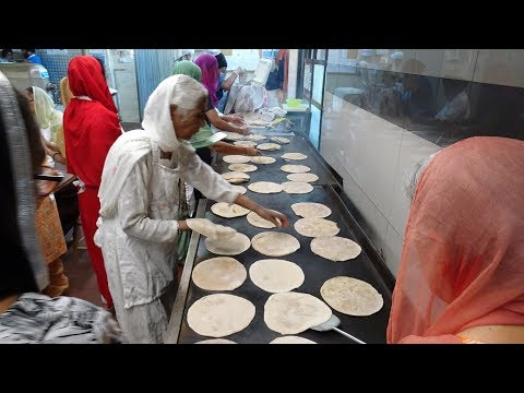 "100s of Free Indian Meals served up Daily at Southall Temple ""Sri Guru Singh Sabha Gurdwara"" London."